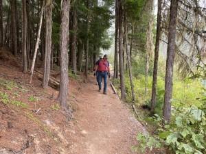 Hiking the short trail to the Huff Lake interpretive display.