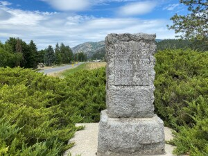 The historical site of Pinkney City, the 1st territorial capitol, can be seen in the distance behind the Fort Colville memorial.
