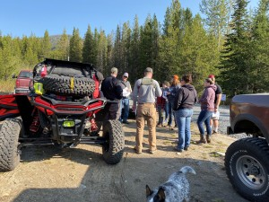 Pre-ride safety briefing - we had  USFS permit that allowed us to use this parking area.